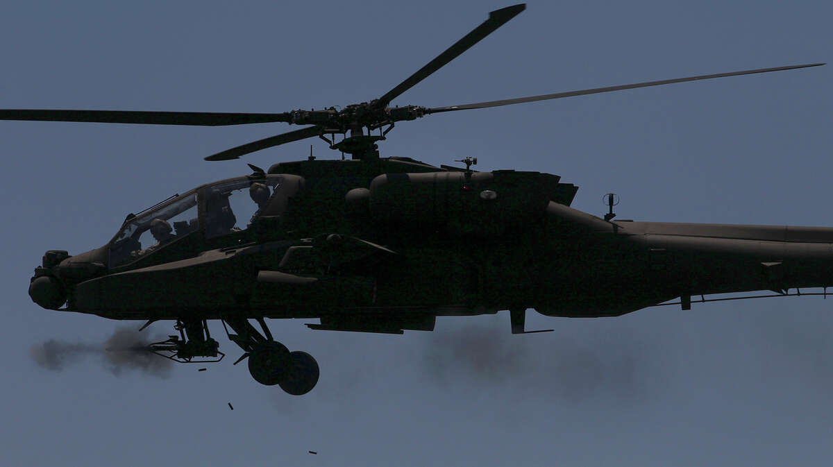 An AH-64D Apache Longbow attack helicopter shoots Monday May 19, 2014 at Fort Hood. Media was invited there by the Texas national Guard to observe aerial gunnery qualifications and live fire exercises.