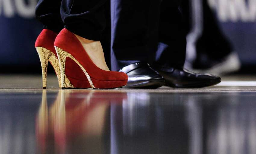 Spurs assistant coach Becky Hammon's red shoes appear before a field of men's dress shoes of her fellow coaches during the game against the Indiana Pacers at the AT&T Center on Wednesday, Nov. 26, 2014. Spurs defeat the Pacers, 106-100. (Kin Man Hui/San Antonio Express-News)