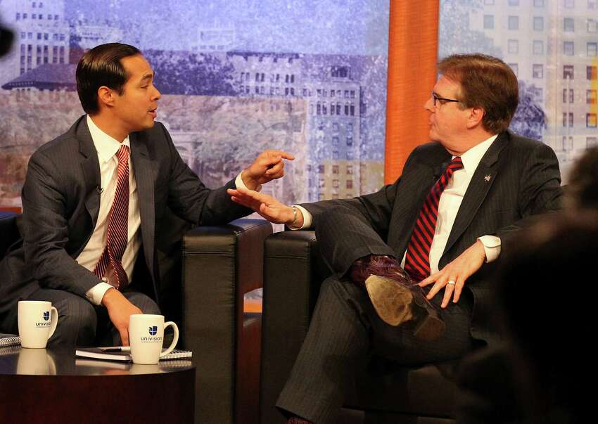 Mayor Julian Castro (left) and State Sen. Dan Patrick, R-Houston, square off for a debate at Univision television on Tuesday, Apr. 15, 2014. (Kin Man Hui/San Antonio Express-News)