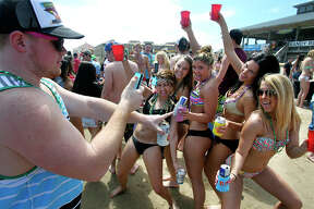 Jeff Heinzer, from College Station, grabs a picture of his friends during Spring Break 2014 on the South Padre Island beach near Clayton's on March 11, 2014.