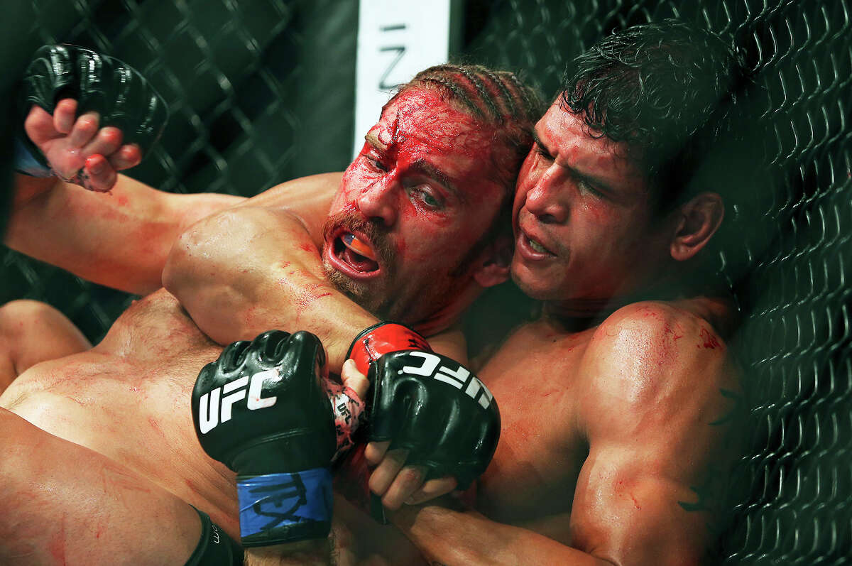 Andrew Craig battles with a bloody face against eventual winner of a middleweight bout Cezar Ferreira during UFC Fight Night at the AT&T Center on June 28, 2014.