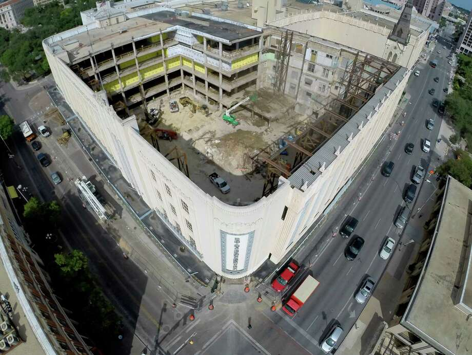 The former Joske's building at the corner of Alamo and Commerce is seen Monday Sept. 15, 2014 in an aerial image taken with a quadcopter. Construction crews on Monday completed demolishing the old, timber-frame structure of the historic Joske�s building as part of the renovation of Rivercenter mall. Part of the demolition included removing the roof of the former department store, at the corner of Alamo and Commerce streets, so crews can begin building 75-foot concrete piers to support the new structure, which soon will house a multi-level H&M store among other tenants. Photo: William Luther, By William Luther/San Antonio Express-News / © 2013 San Antonio Express-News