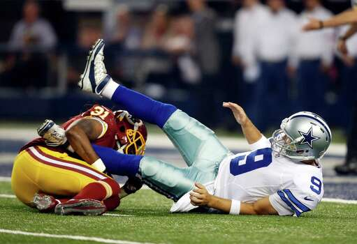 Washington Redskins strong safety Brandon Meriweather (31) knocks down Dallas Cowboys' Tony Romo (9) after Romo returned to play during the second half on Oct. 27, 2014, in Arlington. Photo: Tim Sharp /Associated Press / FR62992 AP