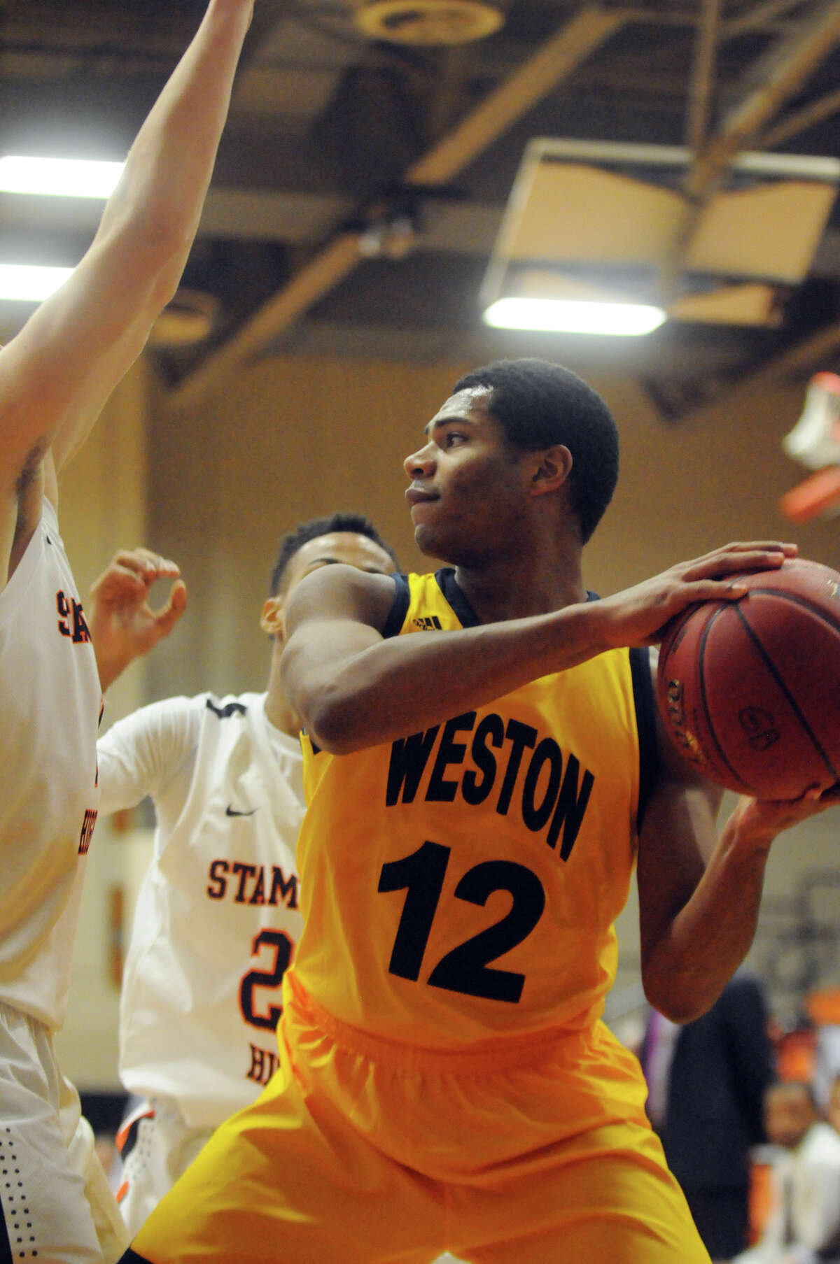 Weston's Nik Parker in action as Stamford High School hosts Weston in a boys basketball game during the Kuzco Tournament at Stamford High School in Stamford, Conn., Dec. 27, 2014.