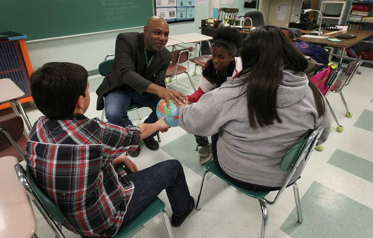 Kitty Hawk Middle School teacher Frederick Ward works with students during a circle session on Tuesday, Dec. 16, 2014. The school will be using restorative discipline starting next year as an attempt to bridge relationships between students and educators to foster a more positive and productive learning environment. Despite not fully utilizing restorative discipline, school officials have already seen marked improvement with student behavior.