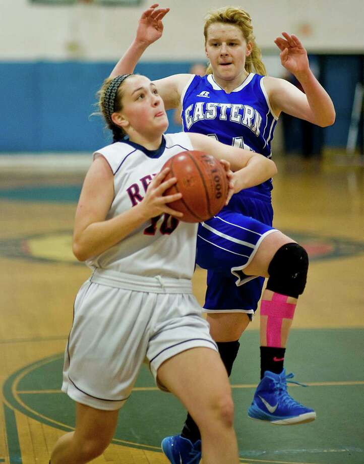New Fairfield High School's Sydney Gouveia, guarded by Bristol Eastern High School's Diana Wnuk, heads to the basket in the Greater Danbury News-Times Holiday Classic championship game at the Danbury War Memorial. Saturday, Dec. 27, 2014 Photo: Scott Mullin / The News-Times Freelance