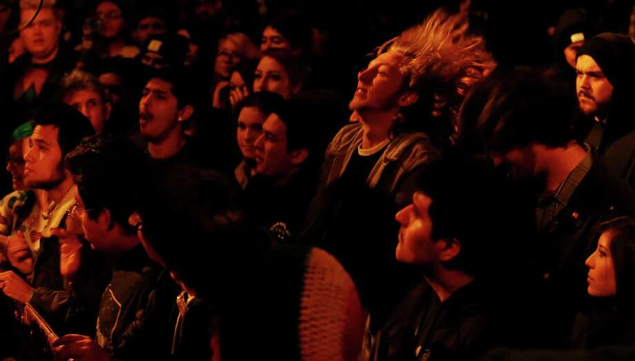 Fans of the band Just A Dream watch the group perform Saturday Dec. 27, 2014 at the White Rabbit, which closed Saturday. The venue will reopen next year with a new name and management. Photo: Edward A. Ornelas, San Antonio Express-News / © 2014 San Antonio Express-News