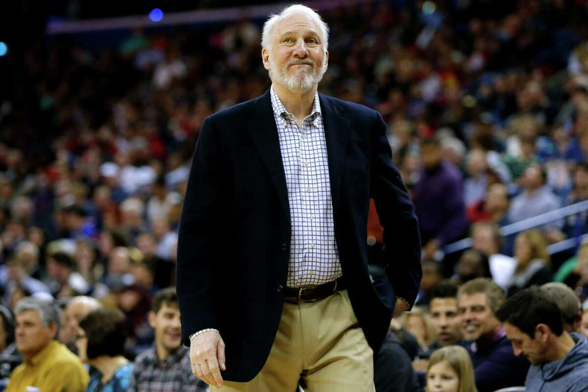 San Antonio Spurs head coach Gregg Popovich reacts during the first half of an NBA basketball game, Friday, Dec. 26, 2014, in New Orleans.