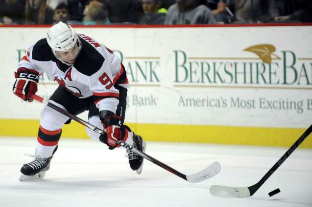 Devils' Joe Whitney chases a loose puck during their hockey game against the Falcons on Saturday, Dec. 27, 2014, at Times Union Center in Albany, N.Y. (Cindy Schultz / Times Union) Photo: Cindy Schultz / 00029286F