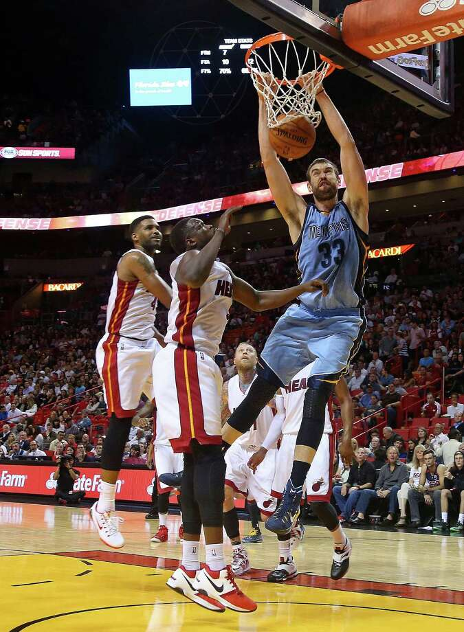 Memphis center Marc Gasol dunks over Luol Deng for two of his 22 points. Gasol also had a game-high 10 rebounds. Photo: Mike Ehrmann / Getty Images / 2014 Getty Images