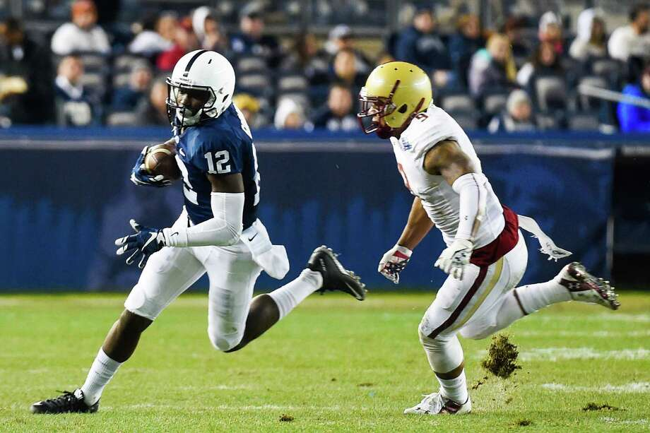 NEW YORK, NY - DECEMBER 27: Chris Godwin #12 of the Penn State Nittany Lions runs from Dominique Williams #9 of the Boston College Eagles in the first quarter of the 2014 New Era Pinstripe Bowl at Yankee Stadium on December 27, 2014 in the Bronx borough of New York City.  (Photo by Alex Goodlett/Getty Images) ORG XMIT: 528870447 Photo: Alex Goodlett / 2014 Getty Images