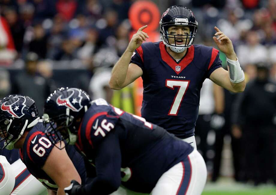 Houston Texans quarterback Case Keenum (7) calls a play against the Baltimore Ravens during the first half on Dec. 21, 2014, in Houston. Photo: Patric Schneider /Associated Press / FR170473 AP