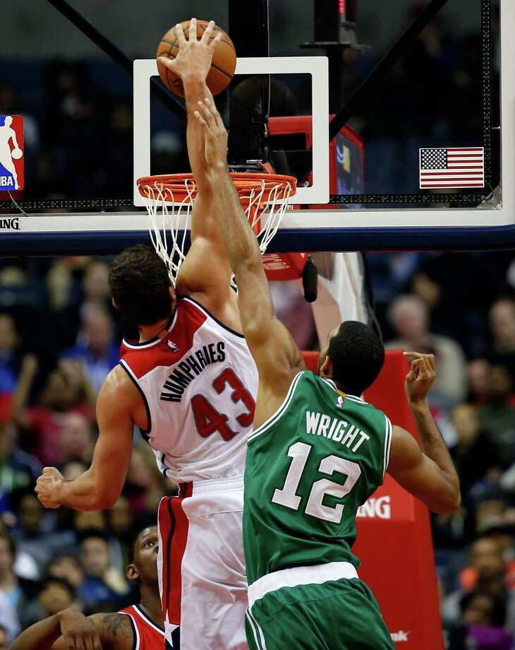 Washington Wizards forward Kris Humphries (43) dunks in front of Boston Celtics forward Brandan Wright (12) in the second half of an NBA basketball game, Saturday, Dec. 27, 2014, in Washington. Humphries had 18 points. The Wizards won 101-88. (AP Photo/Alex Brandon) ORG XMIT: VZN106 Photo: Alex Brandon / AP