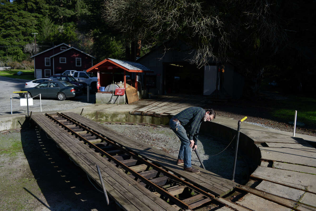Randy Jones prepares the turnstile for a train at the Swanton Pacific Railroad on Monday, Dec. 22, 2014 in Swanton, Calif. A century ago, these miniature trains were used to busk attendees of the Panama Pacific International Expo around the fairgrounds.