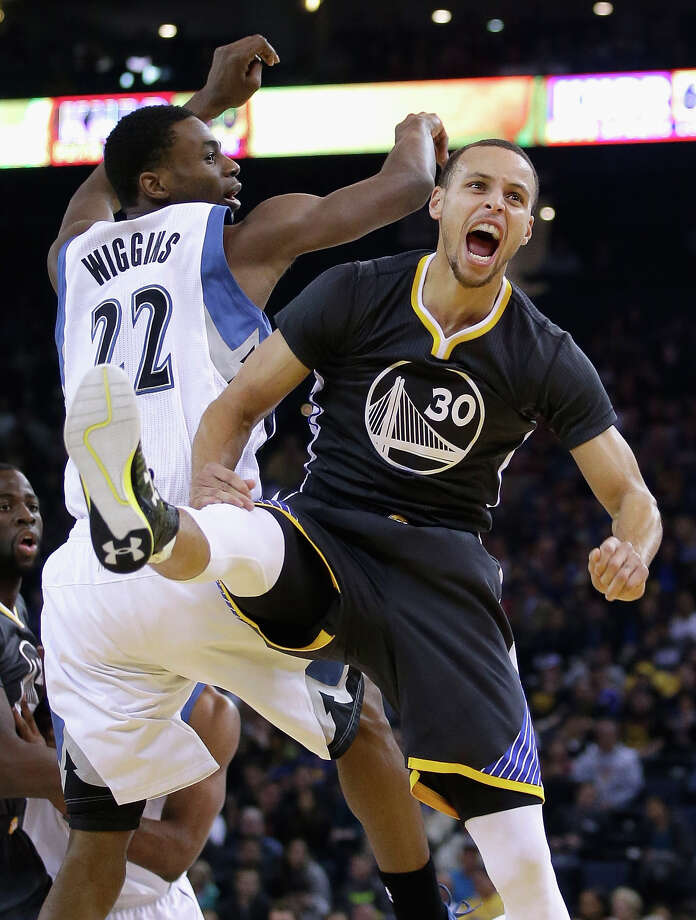 Stephen Curry (30) and his Golden State Warriors  OAKLAND, CA - DECEMBER 27: Stephen Curry #30 of the Golden State Warriors reacts after he won a jump ball against Andrew Wiggins #22 of the Minnesota Timberwolves at ORACLE Arena on December 27, 2014 in Oakland, California. NOTE TO USER: User expressly acknowledges and agrees that, by downloading and or using this photograph, User is consenting to the terms and conditions of the Getty Images License Agreement. (Photo by Ezra Shaw/Getty Images) Photo: Ezra Shaw / Getty Images / 2014 Getty Images