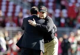 SANTA CLARA, CA - DECEMBER 28:  Head coach Jim Harbaugh of the San Francisco 49ers hugs 49ers owner Jed York before their game against the Arizona Cardinals at Levi's Stadium on December 28, 2014 in Santa Clara, California.  (Photo by Ezra Shaw/Getty Images)