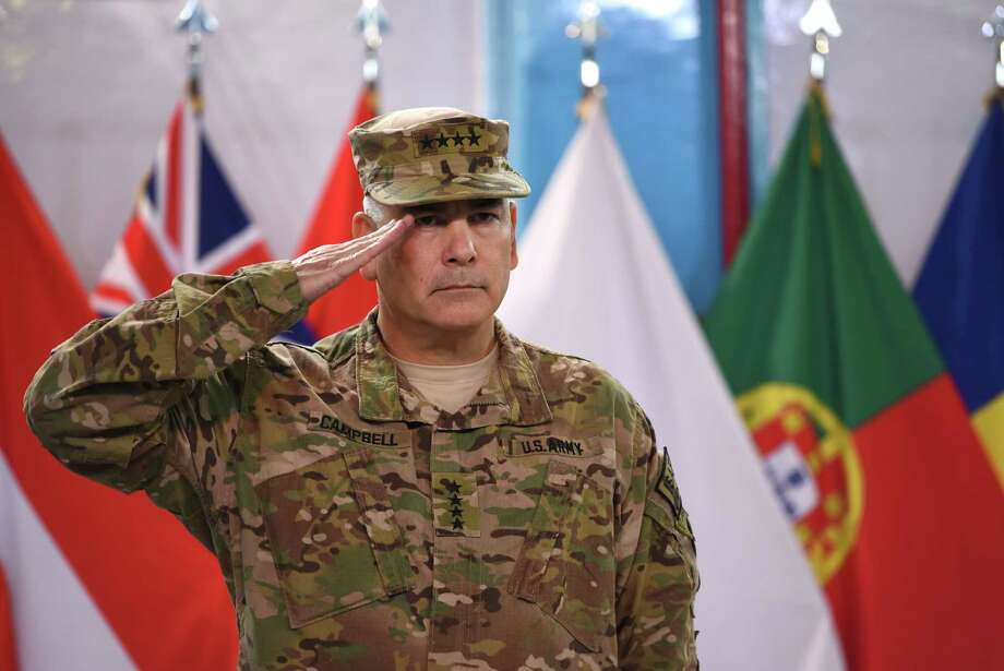 U.S. Gen. John Campbell, commander of the International Security Assistance Force, salutes during a ceremony formally ending the war in Afghanistan. Photo: SHAH MARAI / AFP/Getty Images / AFP