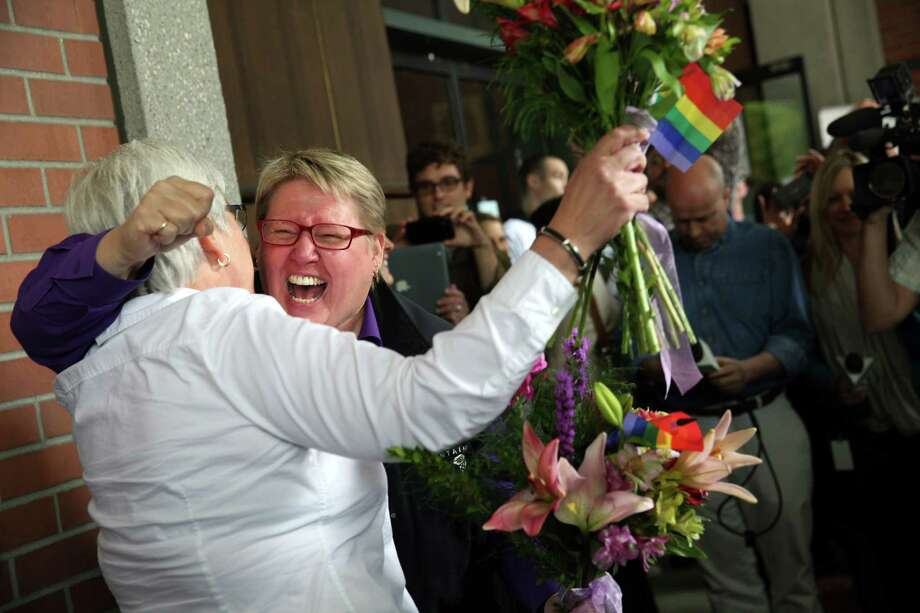 Deanna Geiger (left) and Janine Nelson rejoice when they learn that they can get married in Oregon, one of 35 states where same-sex marriage is legal. Photo: Faith Cathcart / Associated Press / THE OREGONIAN