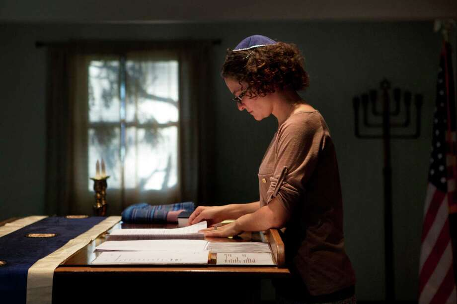 Student rabbi Sara Eiser, visiting from rabbinical school in Cincinnati, goes over her notes before shabbat service at the Synagogue of the Black Hills in Rapid City, S.D. Photo: Kristina Barker / Associated Press / FR171226 AP