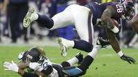 Texans running back Alfred Blue (28) is tripped up by Jacksonville Jaguars cornerback Aaron Colvin (22) during the second quarter of an NFL football game at NRG Stadium on Sunday, Dec. 28, 2014, in Houston. ( Brett Coomer / Houston Chronicle )