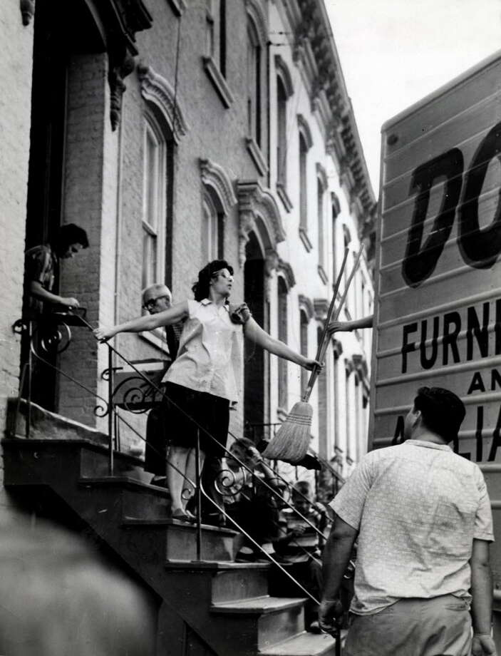 The Robert Fitzmaurice family moves out of their home at 62 Jefferson Street during demolition for the South Mall Sept. 5, 1963, in Albany, N.Y. Historic buildings and streets 1960s, Empire State Plaza. (Times Union archive)