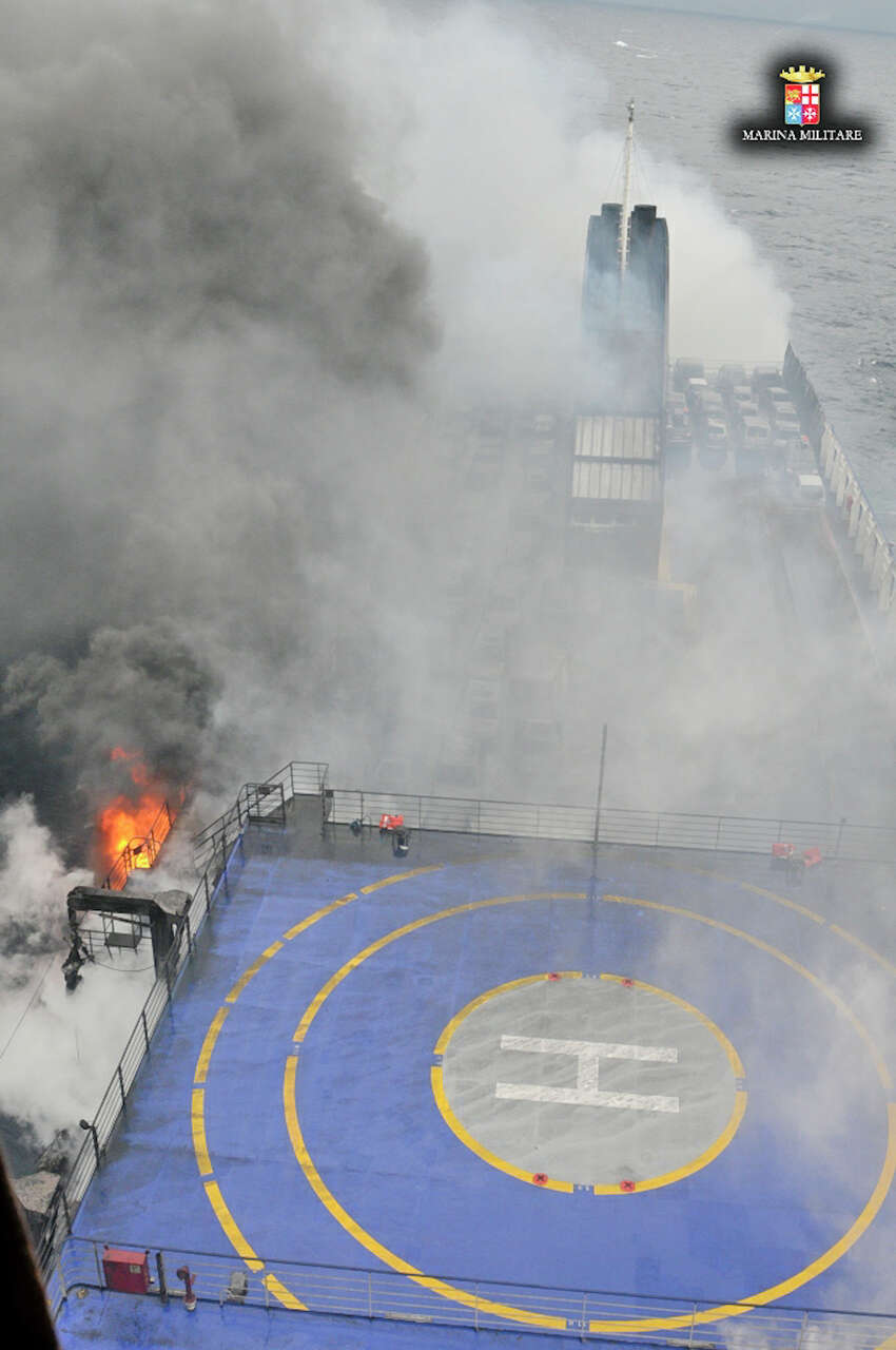 In this image released by the Italian Navy, smoke billows from the Italian-flagged ferry Norman Atlantic that caught fire in the Adriatic Sea, Sunday, Dec. 28, 2014. Italian and Greek rescue crews battled gale-force winds and massive waves as they struggled Sunday to evacuate hundreds of people from a ferry on fire and adrift in the channel between Italy and Albania. At least one person died and two were injured. The fire broke out before dawn Sunday on a car deck of the Italian-flagged Norman Atlantic, traveling from the western Greek port of Patras to the Italian port of Ancona on the Adriatic, with 422 passengers and 56 crew members on board.AP story: 1 dead, hundreds stranded in Greek ferry disaster