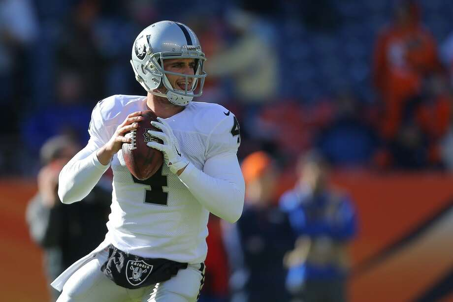 DENVER, CO - DECEMBER 28:  Quarterback Derek Carr #4 of the Oakland Raiders drops back to pass as he warms up before a game against the Denver Broncos at Sports Authority Field at Mile High on December 28, 2014 in Denver, Colorado.  (Photo by Justin Edmonds/Getty Images) Photo: Justin Edmonds, Getty Images