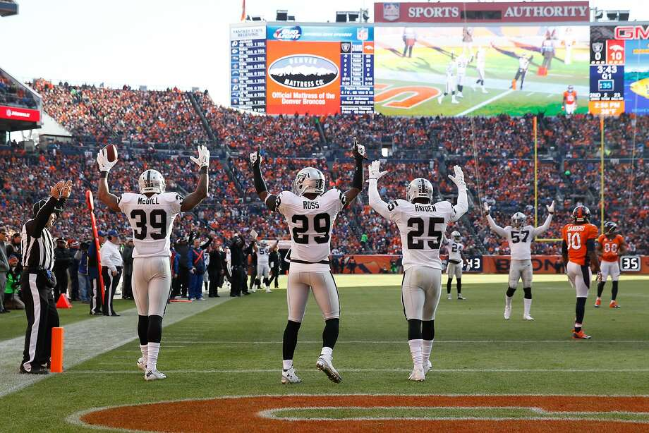 DENVER, CO - DECEMBER 28:  Cornerback Keith McGill #39, strong safety Brandian Ross #29, and cornerback D.J. Hayden #25 of the Oakland Raiders celebrate a touchdown against the Denver Broncos on a backward pass ruled a fumble that was recovered by McGill at Sports Authority Field at Mile High on December 28, 2014 in Denver, Colorado.  (Photo by Doug Pensinger/Getty Images) Photo: Doug Pensinger, Getty Images