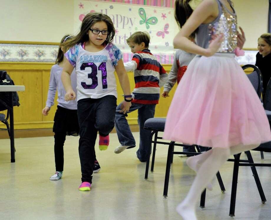 Click through the slideshow to view photos and read stories you may have missed from the weekend. Alexis Hulett, 10, of Colonie plays musical chairs at her birthday party on Sunday, Dec. 28, 2014, in Colonie, N.Y.  Hulett back in 2008 started gathering donated items at her birthday to donate to different organizations after her her grandfather, Kenneth Coons, was injured in an accident.  Coons passed away in 2011after a battle with Leukemia.  Alexis and her family wanted to give back to the community while keeping the memory alive of her grandfather, whom she was very close to.  Last year Hulett collected over 200 books which were given to the Albany Tulip Queen's Literacy campaign.  This year childrenOs toys, books and movies are being collected to donate to the ChildrenOs Hospital at Albany Medical Center.   (Paul Buckowski / Times Union) Photo: Paul Buckowski / 00030002A
