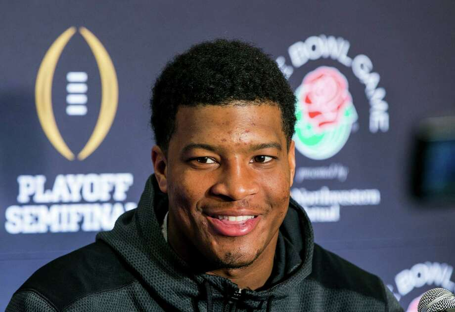 Florida State quarterback Jameis Winston smiles as he takes questions during a news conference in Los Angeles, Sunday, Dec. 28, 2014. Florida State takes on Oregon in the Rose Bowl on New Year's Day. (AP Photo/Damian Dovarganes) ORG XMIT: LA101 Photo: Damian Dovarganes / AP