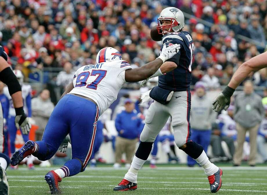 Buffalo Bills defensive tackle Corbin Bryant (97) pressures New England Patriots quarterback Tom Brady, right, in the first half of an NFL football game Sunday, Dec. 28, 2014, in Foxborough, Mass. (AP Photo/Elise Amendola) ORG XMIT: FBO111 Photo: Elise Amendola / AP