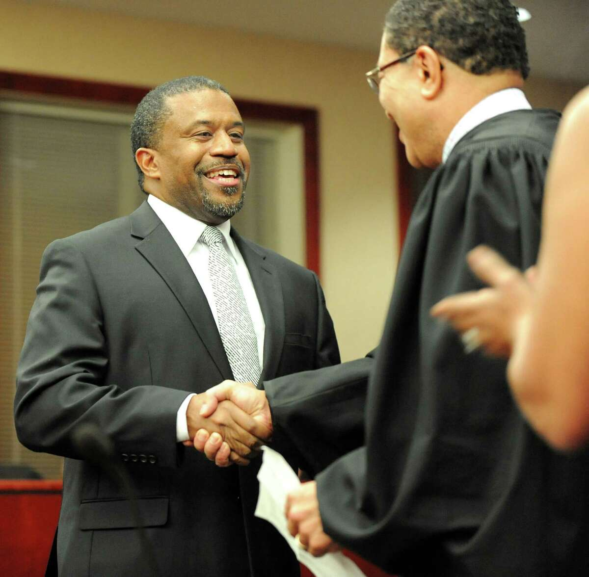 Albany County Family Court Judge Richard Rivera, left, shakes hands with Judge Randolph Treece during Rivera's swearing in ceremony on Friday Dec. 19, 2014, at Albany County Family Court in Albany, N.Y. He is the first Hispanic elected official in any countywide office. (Cindy Schultz / Times Union)