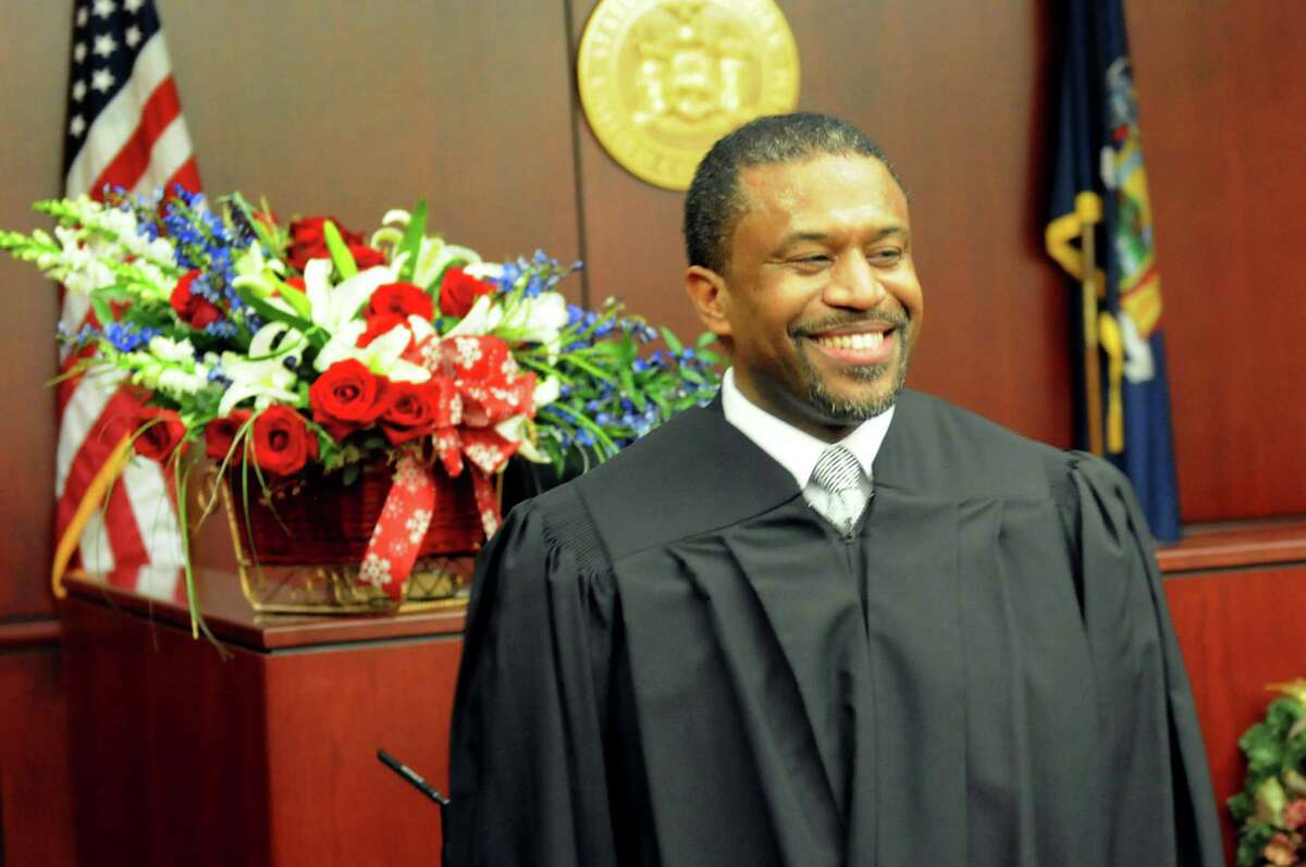 Albany County Family Court Judge Richard Rivera poses in his robe during his swearing in ceremony on Friday Dec. 19, 2014, at Albany County Family Court in Albany, N.Y. He is the first Hispanic elected official in any countywide office. (Cindy Schultz / Times Union)