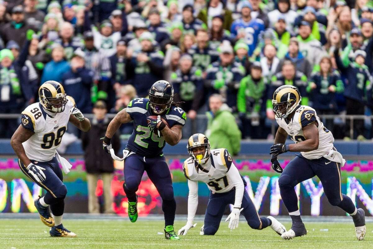 Marshawn Lynch, second from left, dodges Rams defense while on a run downfield during the first half of the final regular season game Sunday, Dec. 28, 2014, at CenturyLink Field in Seattle, Washington. (Jordan Stead, seattlepi.com)