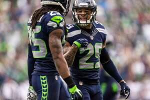 Earl Thomas, center, and Richard Sherman, left, chat between plays during the first half of the final regular season game Sunday, Dec. 28, 2014, at CenturyLink Field in Seattle, Washington. (Jordan Stead, seattlepi.com)