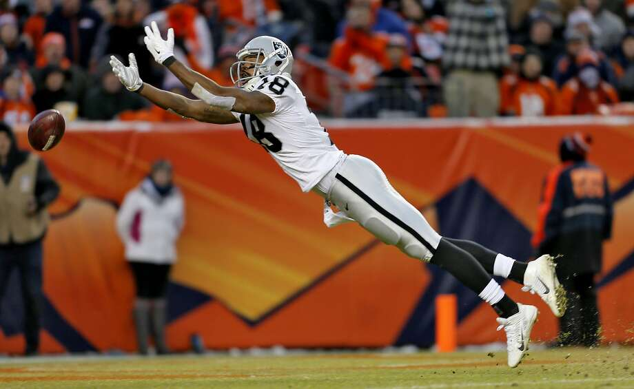 Oakland Raiders wide receiver Andre Holmes can't catch a pass during the second half of an NFL football game against the Denver Broncos, Sunday, Dec. 28, 2014, in Denver. (AP Photo/Joe Mahoney) Photo: Joe Mahoney, Associated Press
