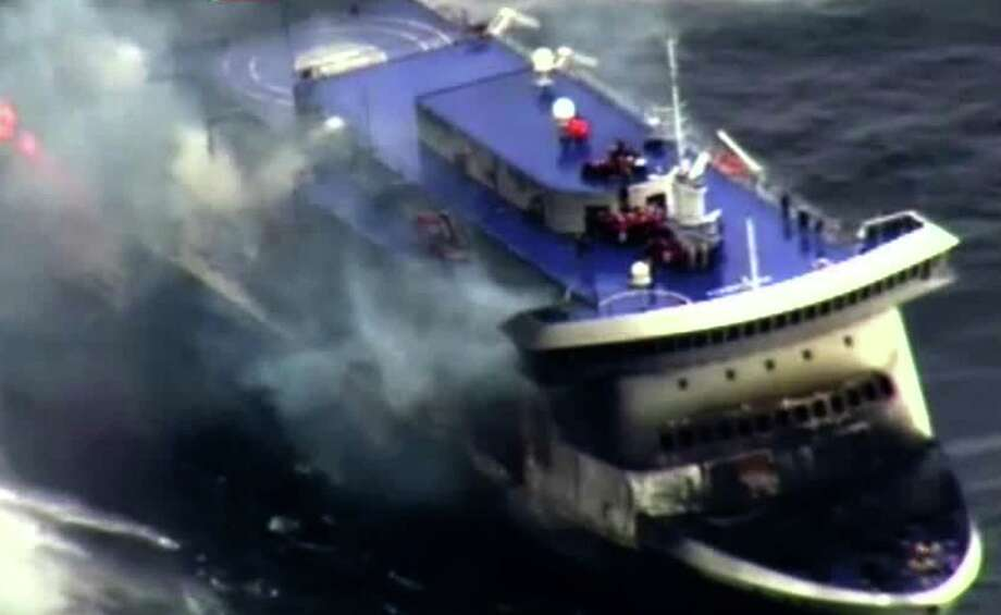 """A photo grab taken from a video made available by the Guardia costiera, Italy's coast guard organization on December 28, 2014, shows the burning ferry """"Norman Atlantic"""" adrift off Albania. Desperate passengers pleaded by mobile phone live on TV to be saved from a burning ferry adrift off Albania as rescuers battled gale-force winds and billowing smoke to get to them. AFP PHOTO / HO/ GUARDIA COSTIERA == RESTRICTED TO EDITORIAL USE - MANDATORY CREDIT """"AFP PHOTO / HO / GUARDIA COSTIERA"""" - NO MARKETING NO ADVERTISING CAMPAIGNS - DISTRIBUTED AS A SERVICE TO CLIENTS ==HO/AFP/Getty Images ORG XMIT: - Photo: HO / AFP"""