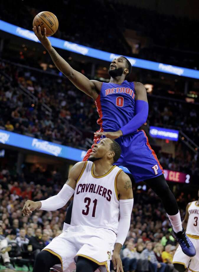 Detroit Pistons' Andre Drummond (0) jumps over Cleveland Cavaliers' Shawn Marion (31) during the first half of an NBA basketball game Sunday, Dec. 28, 2014, in Cleveland. (AP Photo/Tony Dejak) ORG XMIT: OHTD103 Photo: Tony Dejak / AP
