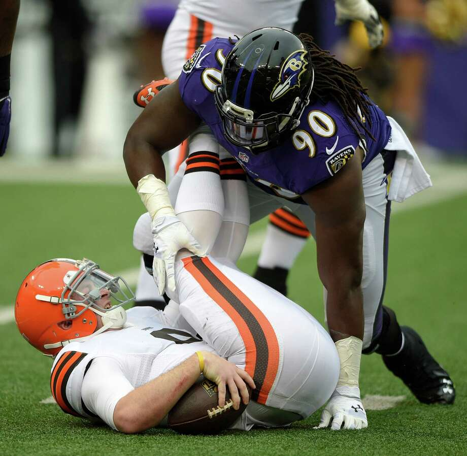 Baltimore Ravens linebacker Pernell McPhee (90) tackles Cleveland Browns quarterback Connor Shaw in the first half of an NFL football game, Sunday, Dec. 28, 2014, in Baltimore. (AP Photo/Nick Wass) ORG XMIT: BAF109 Photo: Nick Wass / FR67404 AP