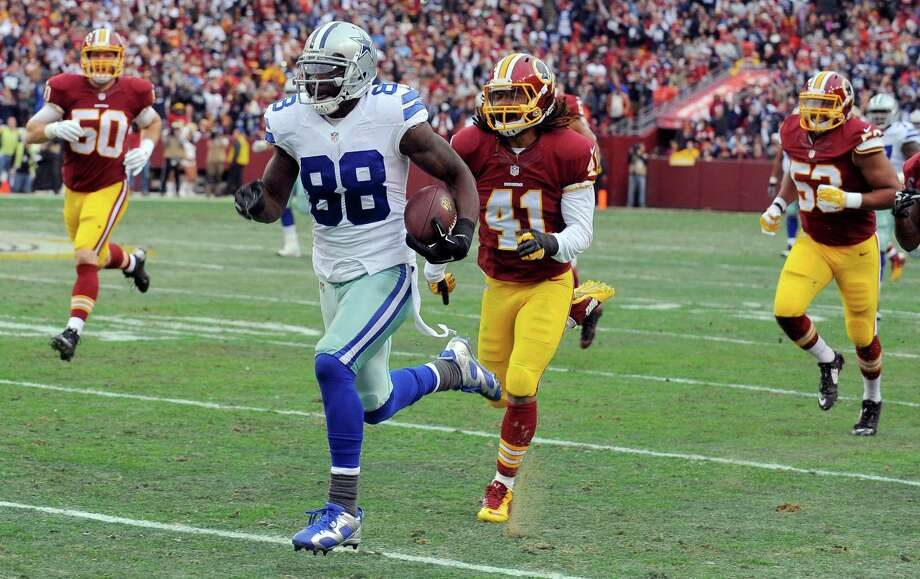 Dallas Cowboys wide receiver Dez Bryant (88) carries the ball away from Washington Redskins strong safety Phillip Thomas (41) for a touchdown during the first half of an NFL football game in Landover, Md., Sunday, Dec. 28, 2014. (AP Photo/Richard Lipski) Photo: Richard Lipski, FRE / Associated Press / AP