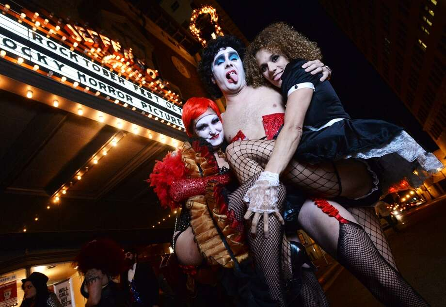 "Krystal and James Williams, left and center, pose for a photo with Bette Daspit, right, outside the Jefferson Theater during Rocktoberfest on Thursday night. The first annual Rocktoberfest was held at the Jefferson Theater on Thursday night. The miniature music festival included performances by Stone Cold, Ramblin' Boys, Jenny and the Reincarnation, and We Were Wolves. St. Arnold was on hand to serve up beer and the performances were followed by a showing of ""The Rocky Horror Picture Show"" inside the Jefferson. Photo taken Thursday 10/30/14 Jake Daniels/@JakeD_in_SETX"