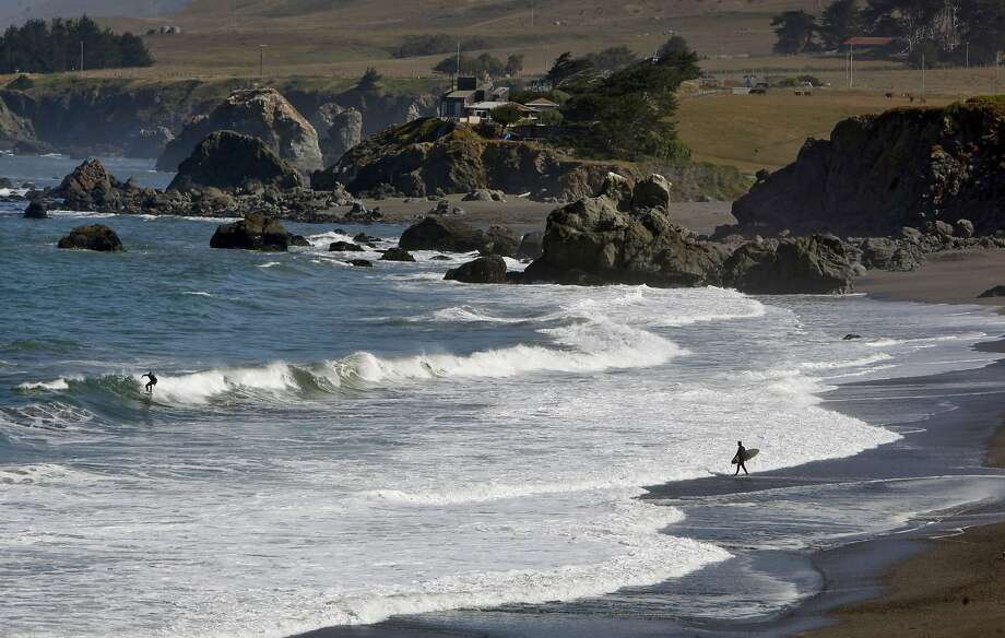 Surfers at Portuguese Beach, near Jenner, Calif. on Friday June 14, 2013, along the Sonoma County coastline. Visitors may soon see a charge for the nearby parking lot.The California state parks system is eyeing parking fees for parts of the Northern California shoreline where none have existed. Citing the need to raise money but their fee plan is facing resistance for state coastal regulators worried about eroding beach access and from environmentalists, who while sympathetic to state parks' plight say it's akin to monetizing the coast. Photo: Michael Macor, The Chronicle