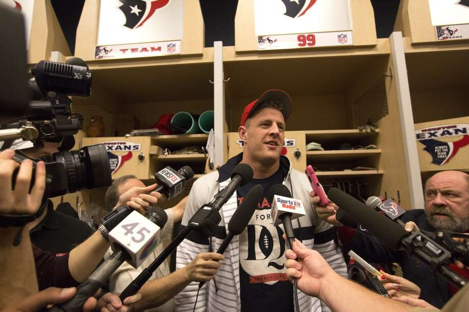Houston Texans defensive end J. J. Watt answers questions in the team's locker room, Monday. The Texans cleaned out their lockers on Monday, a day after they finished the 2014 season 9-7. Photo: Cody Duty, Houston Chronicle