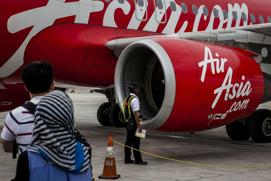 JAKARTA, INDONESIA - DECEMBER 28:  Air Asia Technician checks the airplane for preparation before take off  at Soekarno Hatta International Airport on December 28, 2014 in Jakarta, Indonesia. AirAsia announced that flight QZ8501 from Surabaya to Singapore, with 162 people on board, lost contact with air traffic control at 07:24 a.m. Sunday local time.  (Photo by Oscar Siagian/Getty Images) Photo: Oscar Siagian, Getty Images