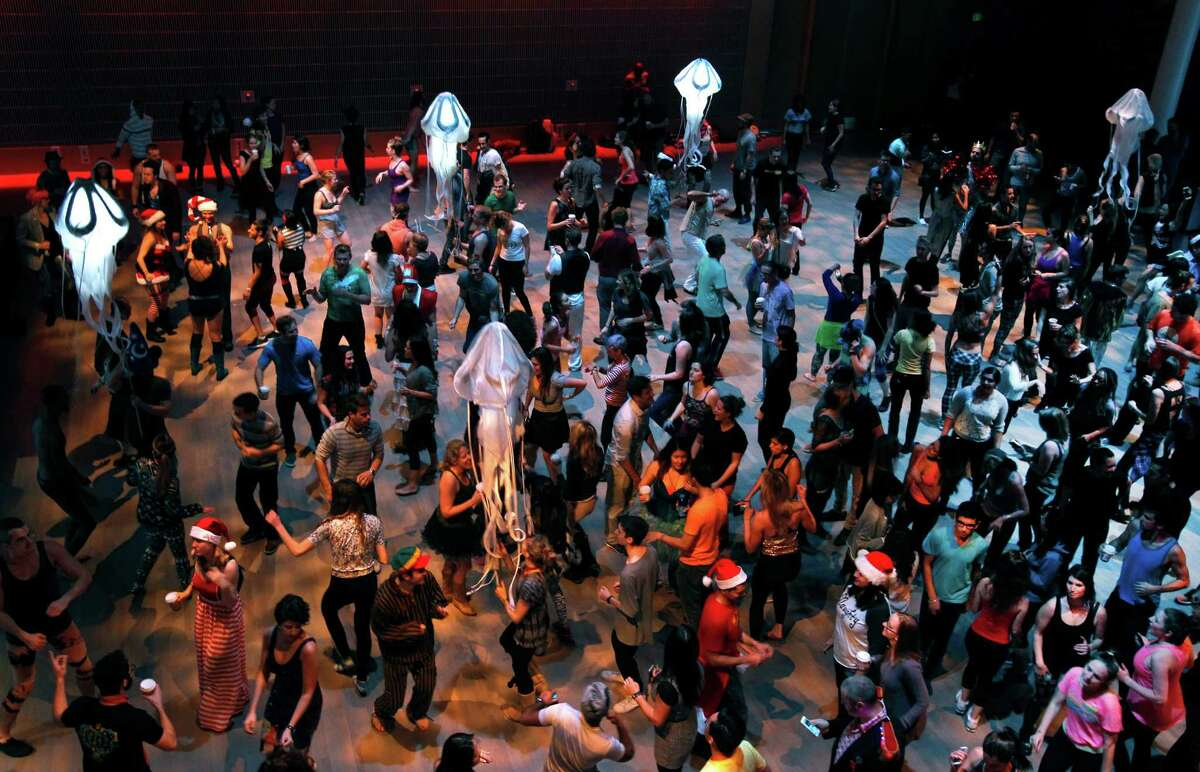 At Yerba Buena Center for the Arts, a crowd dances at an early morning party presented by Daybreaker, one of two firms hosting morning dance events.