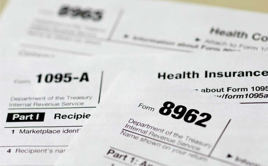 Health care tax forms 8962, 1095-A and 8965 have been added this year. In 2015, all taxpayers have to report to the IRS for the first time whether they had health insurance the previous year. Most will check a box. The IRS also will start collecting fines from some uninsured people and deciding if others qualify for exemptions. Photo: Carolyn Kaster /Associated Press / AP
