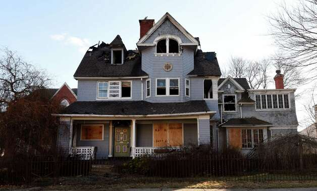 A stately home at 532 Third Avenue on Monday morning, Dec. 29, 2014, shows damage from a suspicious fire that occurred Dec. 27 in the Lansingburgh are of Troy, N.Y.  (Skip Dickstein/Times Union archive) Photo: SKIP DICKSTEIN