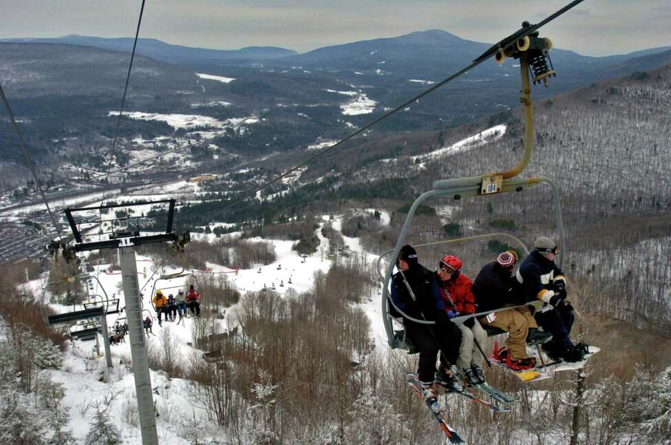 A 2006 file photo showing skiers riding the D chairlift past the Katskill Mountain Club at the base of Hunter Mountain in Hunter, N.Y. A New York City woman died Sunday, Dec. 28, 2014, after falling from the D ski lift at Hunter. (Philip Kamrass/Times Union archive)