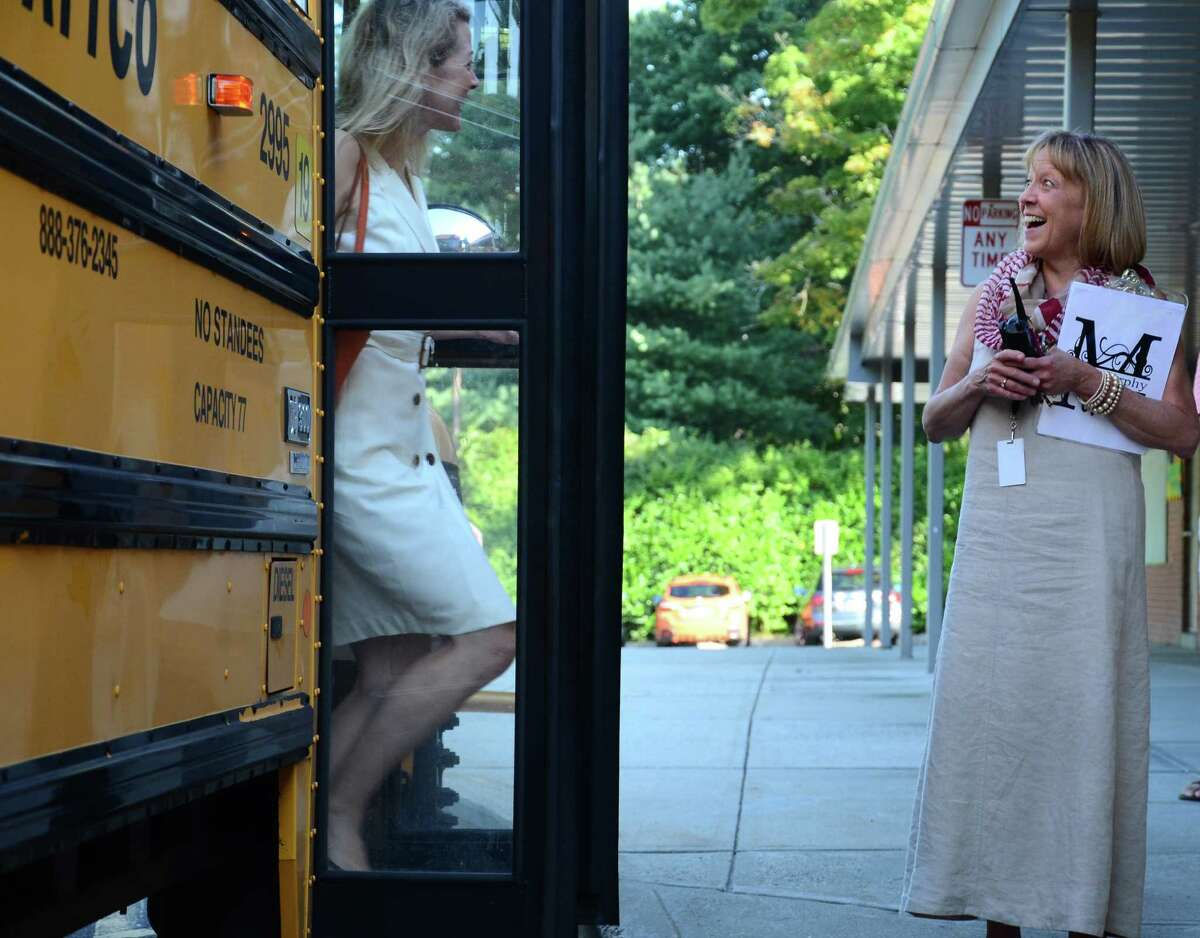 New Canaan August 27 West Elementary School Principal Jan Murphy, right, greets students and parents as they get off the bus for the first day of school Wednesday, Aug. 27, 2014, in New Canaan, Conn.