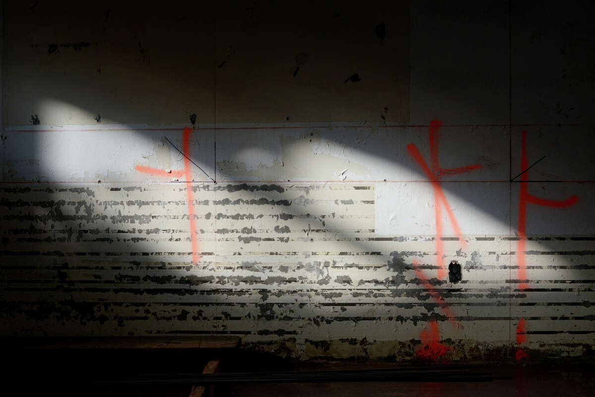 Markings for construction are seen on the wall os an old racquetball court on Monday, Dec. 22, 2014 in Sunnyvale, Calif. The new building will produce as much energy as it consumes.